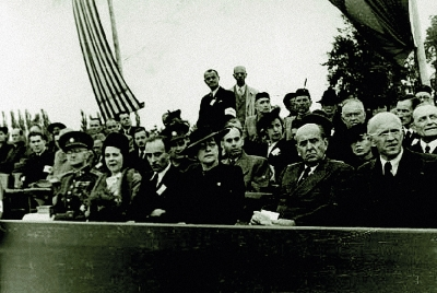 The national funeral in Terezin September 16, 1945. On the grand stand M. Horáková and J. Masaryk (sitting second from the right)