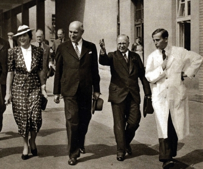 Milada Horáková and Alois Štůla (second from the left) accompanying british minister of health in Masaryk Houses, 1937