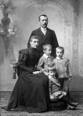 With his parents, Joseph and Mary, and with his siblings,